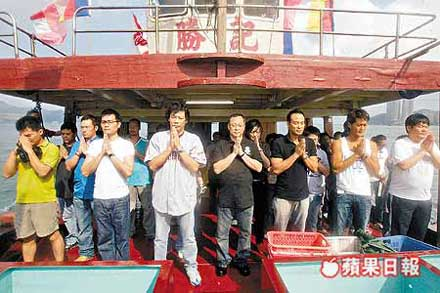 Lam Suet, Johnnie To and Louis Koo releasing fish to atone for the violence in ELECTION 2